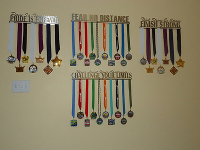 Our medals from all of our races displayed on hangers that we thought sent positive messages