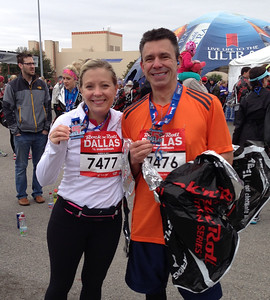 Cathy and I sporting our new race bling after the race