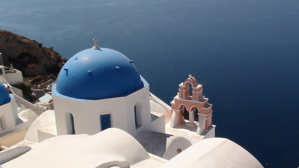 Views of the Island of Santorini and the Sea of Crete from the cliff edges of Oia
